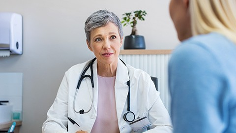 Gynecology Doctor speaking with patient