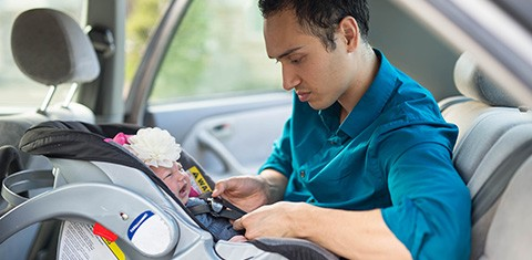 Dad in car with baby in car seat