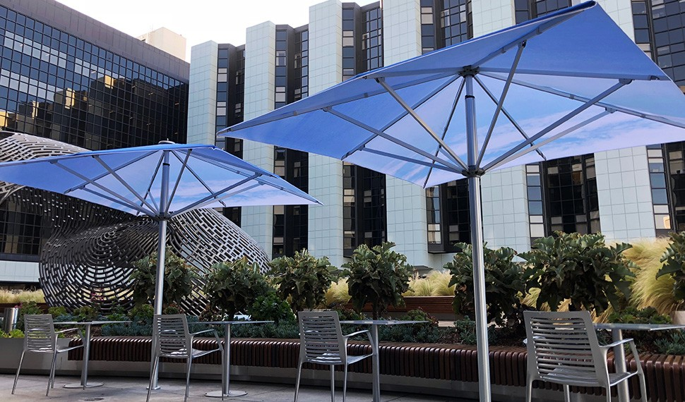 Conceptual artist John Baldessari, a California native, brings his vision of blue skies over the ocean to the shade umbrellas in the Healing Gardens.