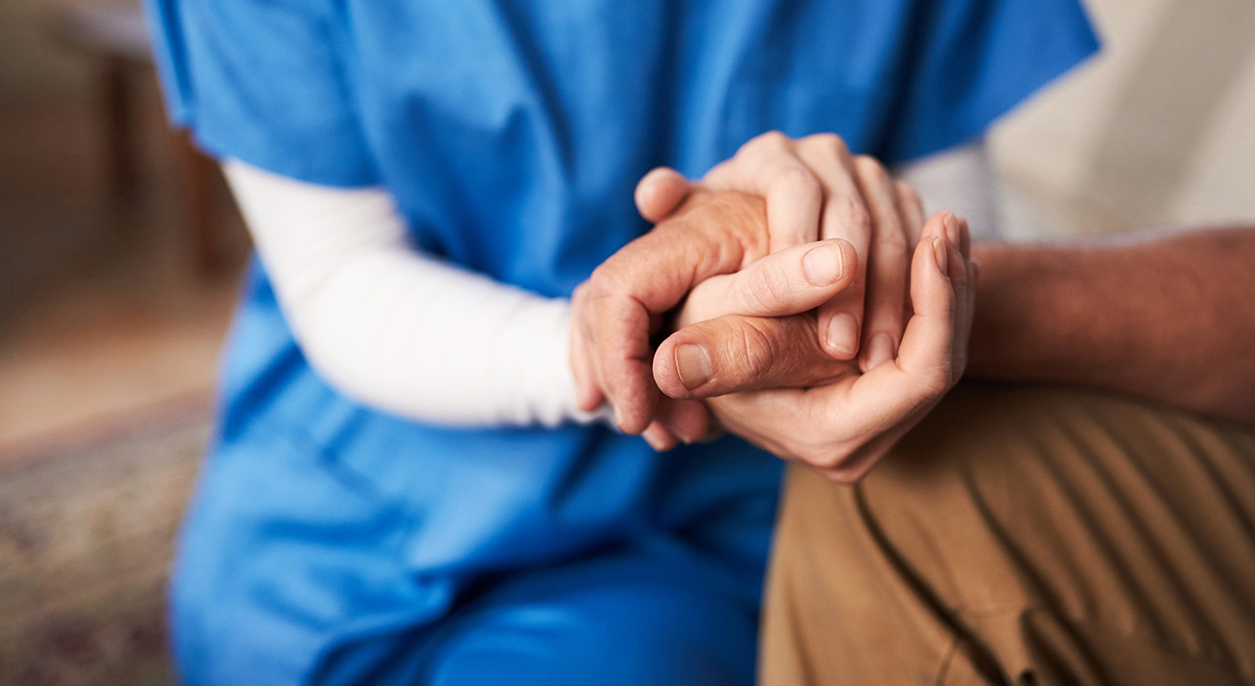 Cropped shot of a female nurse hold her senior patient's hand