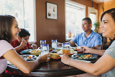Minerva Quezada eating with her family