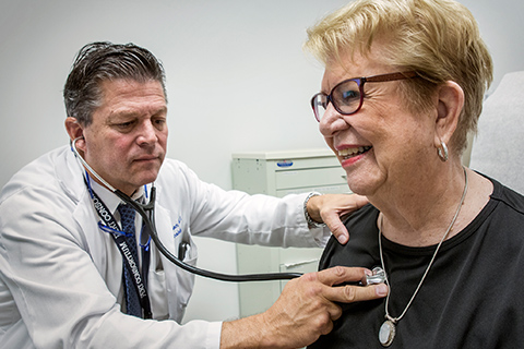 Doctor Victor Tapson examines patient Carol Albright after treating her for deep vein thrombosis and pulmonary embolism.
